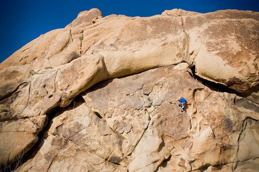 Stock Photo: 4033-463 Girl rock climbing, Joshua Tree National Monument, California, USA