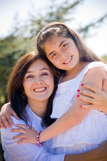 Stock Photo: 4033-481 Mature woman smiling with her granddaughter