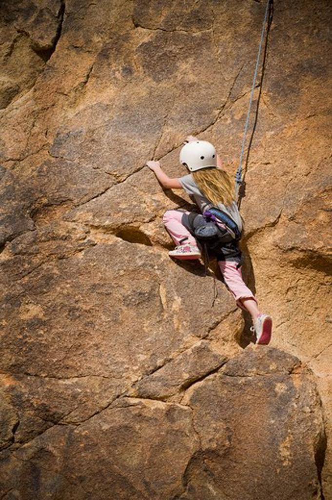 Girl rock climbing, Joshua Tree National Monument, California, USA : Stock Photo