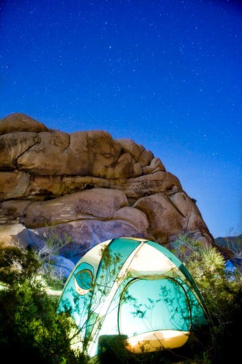 Dome tent lit up at night, Joshua Tree National Monument, California, USA : Stock Photo