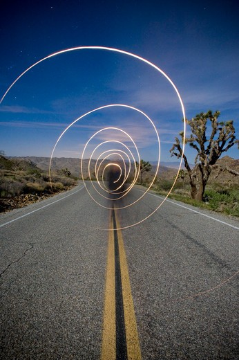 Long exposure of flash light on the road, Joshua Tree National Monument, California, USA : Stock Photo