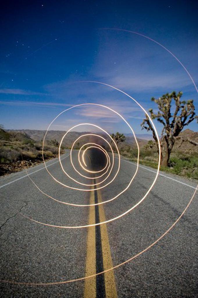 Long exposure of flash light on the road, Joshua Tree National Monument, California, USA : Stock Photo