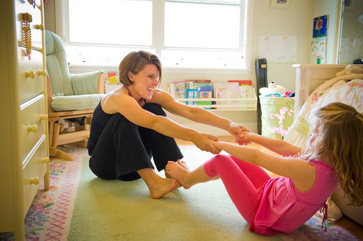 Stock Photo: 4033-499B Young woman playing with her daughter in the house