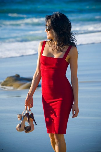 Mid adult woman walking on the beach : Stock Photo