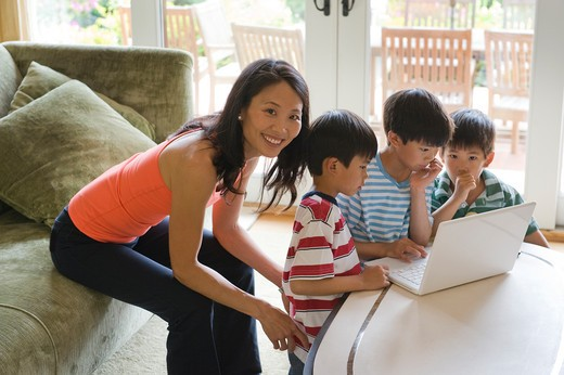 Stock Photo: 4033-509A Family using a laptop