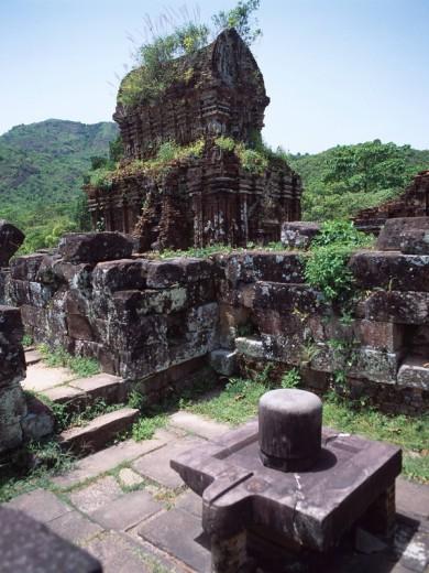 Stock Photo: 4034-12245 The ruins of My Son Sanctuary World heritage Myson Vietnam Sky Mountain Tree Ruins