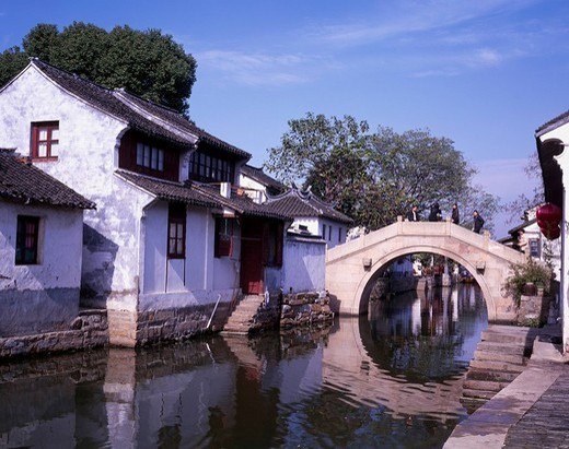 Autumn Zhouzhuang, Row of houses, Suzhou, Jiangsu, China, Row of houses, reflection, bridge, blue sky, people, November : Stock Photo