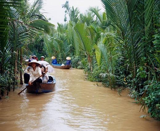 Mekong cruise My Tho Vietnam Ship People Umbrella Tree Aodai : Stock Photo