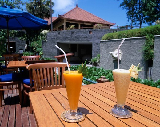 Terrace Glass Parasol Tropical fruit juice mango juice pineapple juice Bali Island Indonesia : Stock Photo