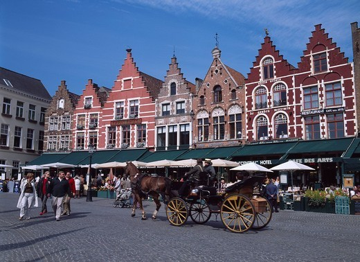 Stock Photo: 4034-3537 Grote Markt City View Carriage Bourges Belgium Blue sky Animal Mammals Wheel Stone Pavement People Streetlight Parasol Shop, Store