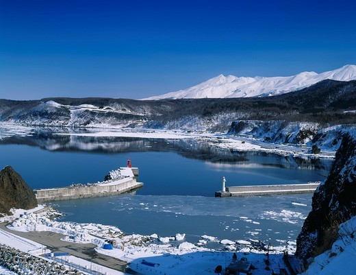 Utoro port, Shiretoko range of mountains, Drift ice, Shari, Hokkaido, Japan : Stock Photo