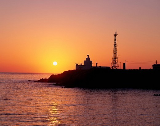 Stock Photo: 4034-51358 Lighthouse Sunrise Nosappu cape Cape Nemuro Hokkaido Japan Morning sun Sun Water surface Reflection Sea