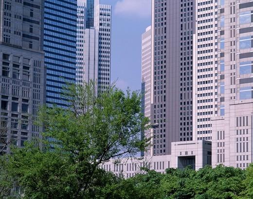 Concept Shinjuku Sky Scraper Business Shinjuku Tokyo Japan Tree Green Blue sky Clouds : Stock Photo
