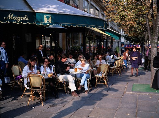 In Deux Magots cafe Paris France Terrace Chair People Shadow Roadside tree : Stock Photo