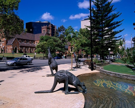 Blue sky Clouds Road Roadside trees The Adelaide terrace passage Kangaroo statue Perth The West Australia state Australia : Stock Photo