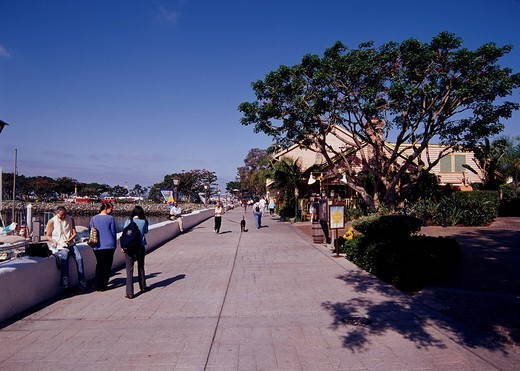 Seaport Village San Diego United States of America Blue sky People Tree Building : Stock Photo