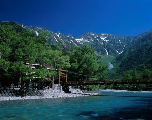 Stock Photo: 4034-65982 Fresh green Kappa bridge Azumi Kamikochi Nagano Japan Sky Mountain Unmelted snow Tree Bridge Mountain stream