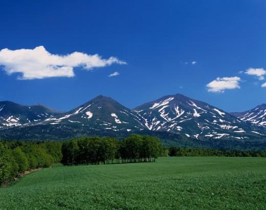 Fresh green Tokachi Mountains Biei Hokkaido Japan Blue sky Clouds Mountain Tree Unmelted snow Green : Stock Photo
