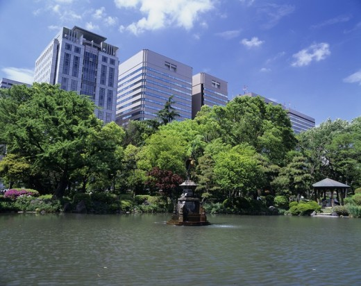 Cloud shape pond Fresh green Hibiya Park Tokyo Japan Blue sky Clouds Building Tree Pond : Stock Photo