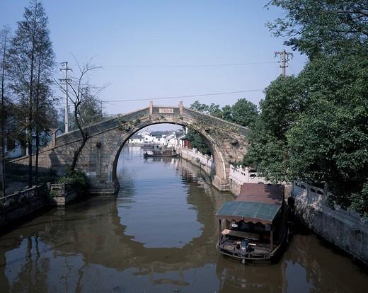 Jiancun Bridge, Canal, Suzhou, Jiangsu, China, canal, bridge, ship, water surface, reflection, tree, green, blue sky, November : Stock Photo