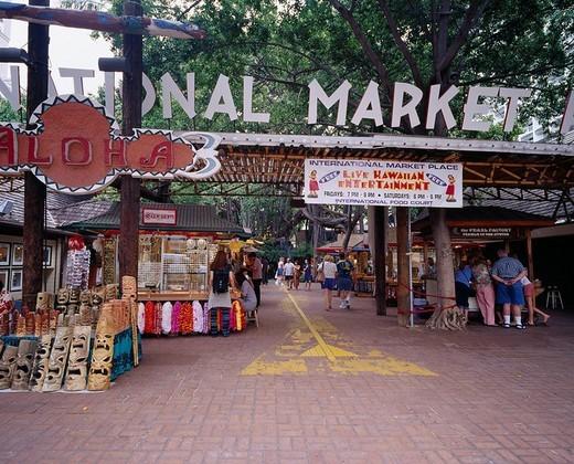 Stock Photo: 4034-74141 Souvenir shop Lei Flower Folkcraft Tourist Stone Pavement Aloha International Market Place Oahu and Hawaii
