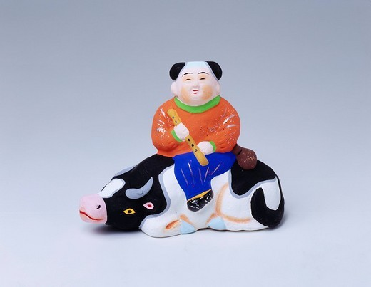 Obata clay figure, child riding cow, Kanzaki_County, Shiga, Kinki, Japan, July : Stock Photo