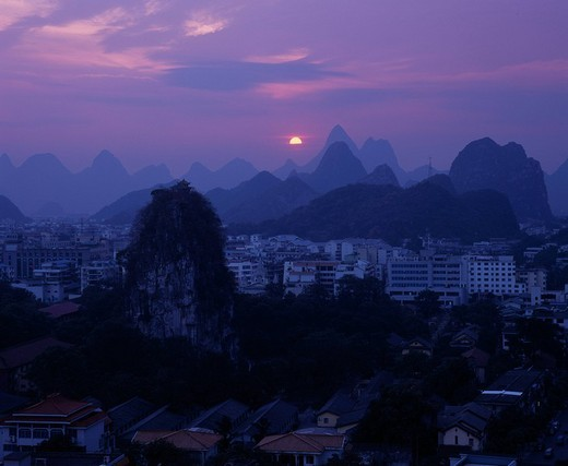 Setting sun, Duxiufeng, Guilin, Guangxi, China : Stock Photo