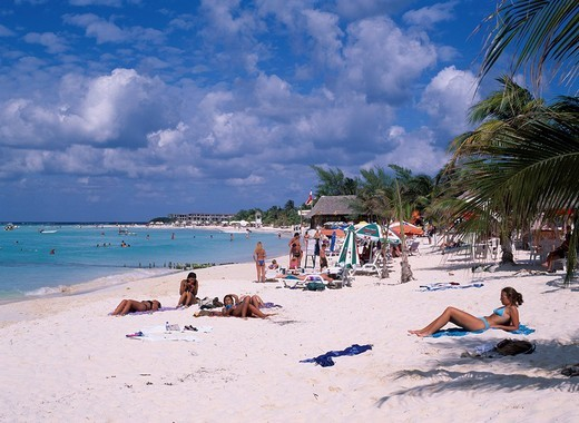 Coco Beach Isla mujeres Cancun Mexico Blue sky Clouds Sea Sandy beach Sea bathing People Swimsuit Tree : Stock Photo