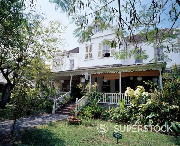 Stock Photo: 4034-87513 Devon Haus Kingston Jamaica Blue sky Tree Green House