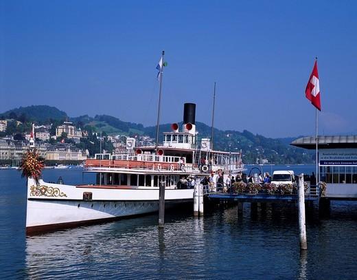 Harbor Blue sky National flag Luzern lake Tourist ship landing stage Luzern Switzerland : Stock Photo