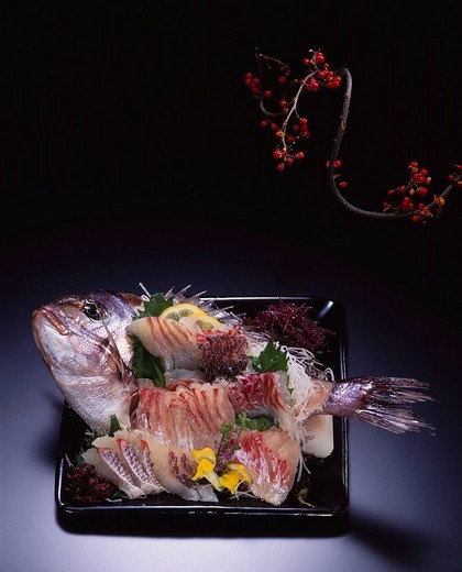 Sea bream Sliced raw fish Branch Fruit Flower Lemon Beefsteak plant Spices Yellow : Stock Photo