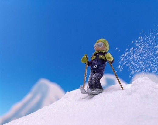 Stock Photo: 4034-96549 Doll Powdery snow Goggles Hat Gloves Blue sky Silvery snow The skier of a snow-covered mountain