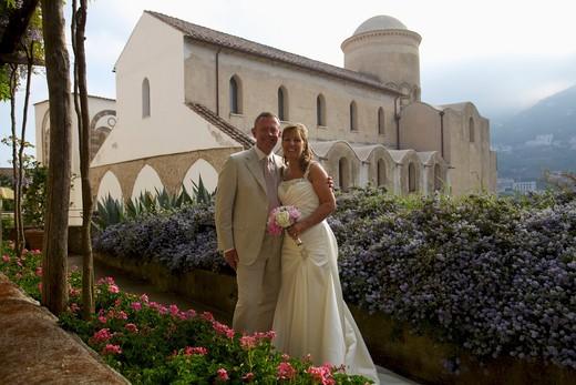 Stock Photo: 4038-101 Newlywed couple smiling in the garden, Hotel Caruso, Ravello, Salerno, Campania, Italy