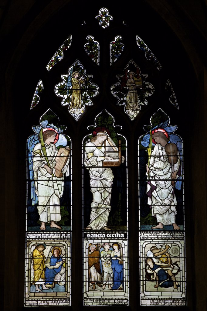 Saint Cecilia and Two Angels by Edward Burne-Jones on stained glass windows in a church, Christ Church, Oxford University, Oxford, Oxfordshire, England : Stock Photo