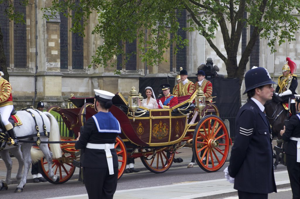 Stock Photo: 4042-1637 Prince William and Princess Catherine travelling in a 1902 State Landau outside Westminster Abbey on 29th April 2011, London, England