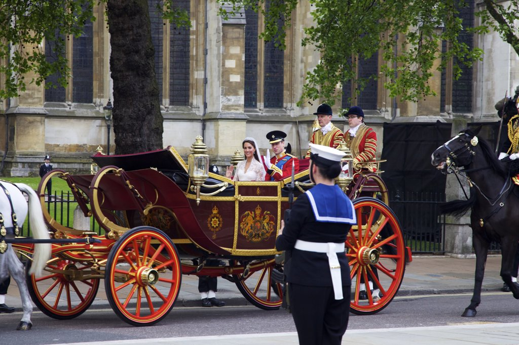 Prince William and Princess Catherine travelling in a 1902 State Landau outside Westminster Abbey on 29th April 2011, London, England : Stock Photo