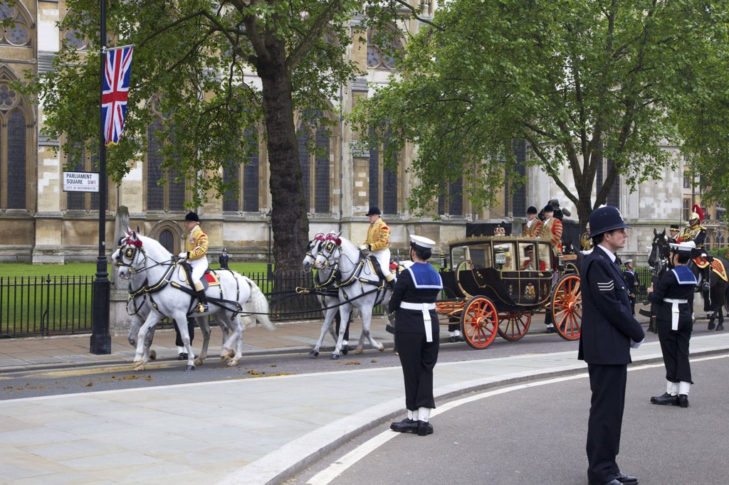 Stock Photo: 4042-1640 Four Windsor grey horses pulling the Scottish state coach which carries Queen Elizabeth II and the Duke of Edinburgh outside of Westminster Abbey for participating in marriage of Prince William to Kate Middleton on 29th April 2011, London, England