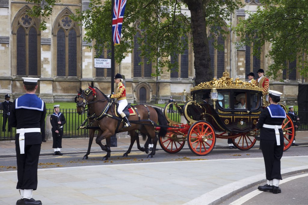 Royal carriage carries Prince Charles and Camilla with Michael and Carole Middleton outside of Westminster Abbey for participating in marriage of Prince William to Kate Middleton on 29th April 2011, London, England : Stock Photo