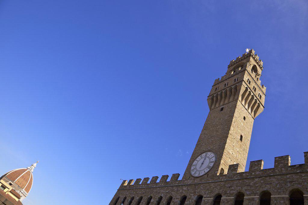 Stock Photo: 4042-2003 Low angle view of Duomo Santa Maria Del Fiore and clock tower of Palazzo Vecchio, Piazza della Signoria, Florence, Tuscany, Italy