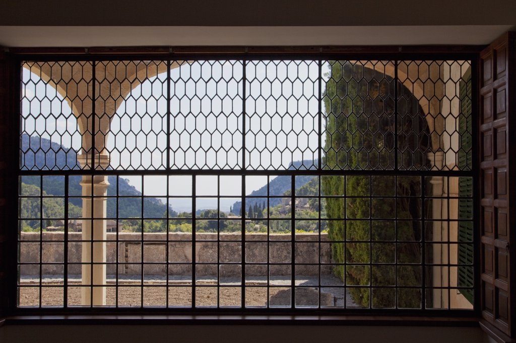 Stock Photo: 4042-218 Mountains viewed through the window of a monastery, Valldemossa Charterhouse, Valldemossa, Majorca, Balearic Islands, Spain