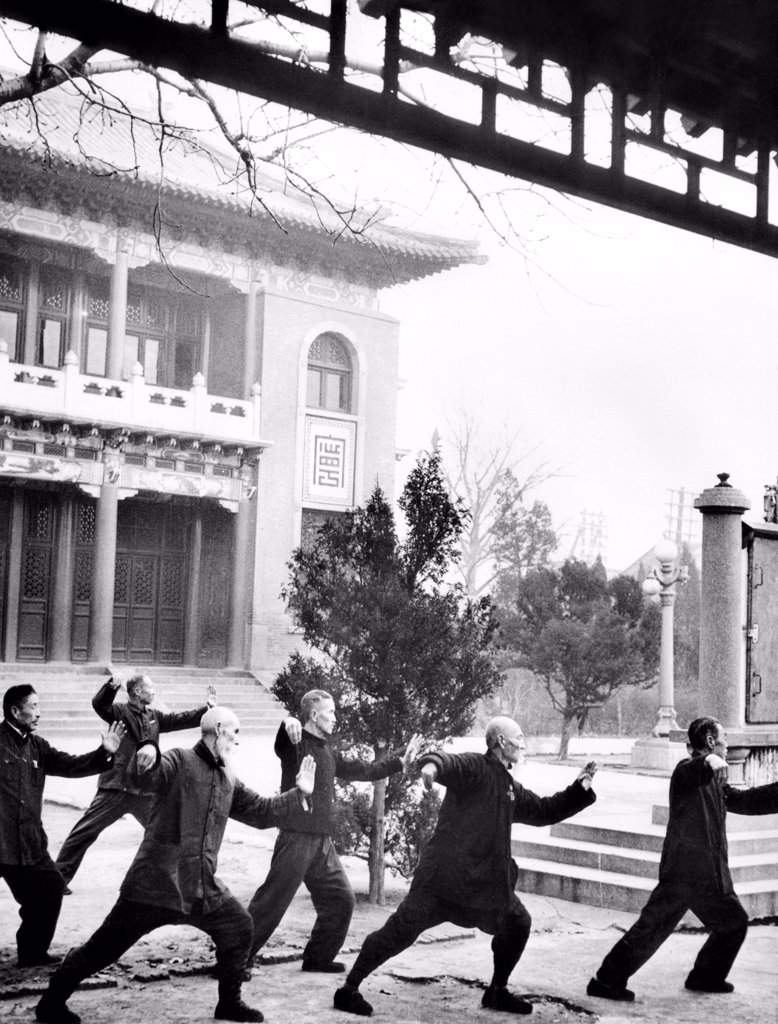 Stock Photo: 4048-10002 Middle-aged Chinese men practice T'ai chi in Hopei Province, Communist China. Jan. 1962.