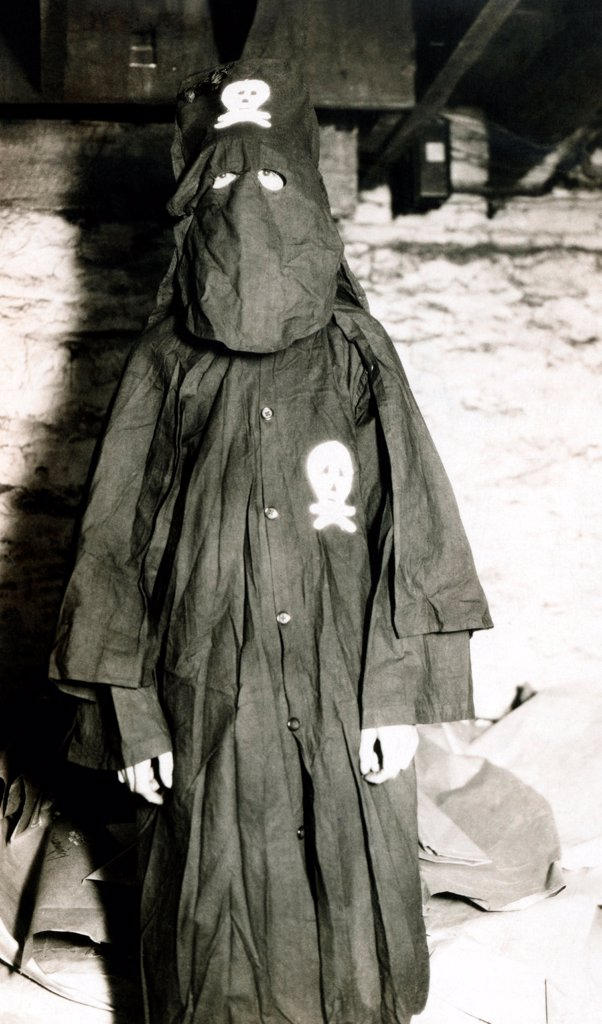 Stock Photo: 4048-10046 Black Legion member in his night rider robes. They splintered from the Ku Klux Klan and were led by William Shepard in Ohio. The groups were suspected of murders of alleged communists and socialists. They were known to have murdered a of black laborer Silas Coleman, and a Charles Poole, WPA worker. June 1936.