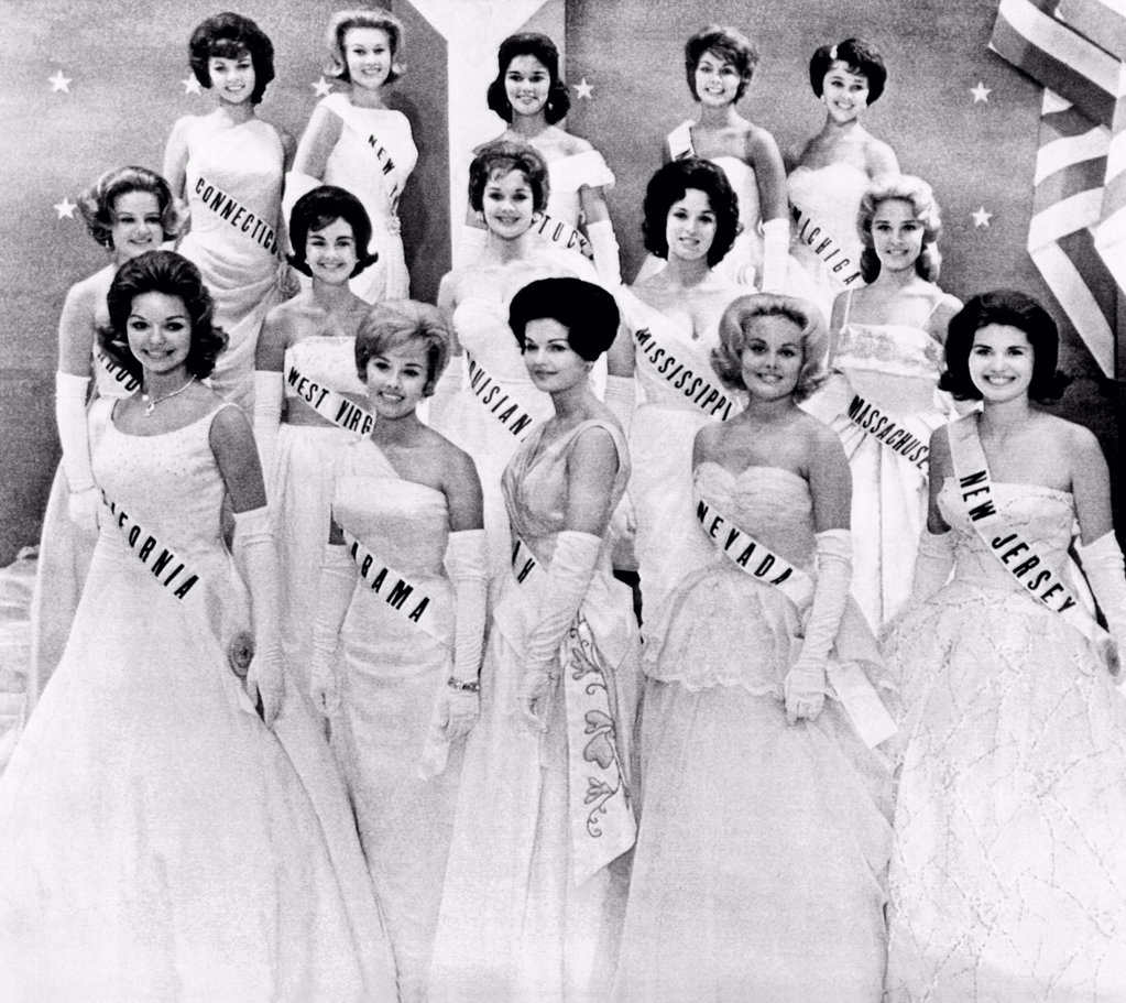 Stock Photo: 4048-10057 Miss USA 1961 finalists in the first phase of the Miss Universe Pageant in Miami Florida. July 12, 1961. The girls are L-R: front row: Pamela Stettler, CA, Suellen Robinson, AL, Janet Hawley, UT, Karen Weller, NV, Diana Giersch, NJ. Middle row: Joan Zeller, RI, Kathy McManaway, WV, Sharon Brown, LA, Marlene Britsch, MS, Elaine Cusick, MA,. Top Row: Fiorene Mavetta, CT, Alexandra Currey, NY, Marcia Chumbler, KY, Gail Weinstock, NE, and Patricia Squires, MI