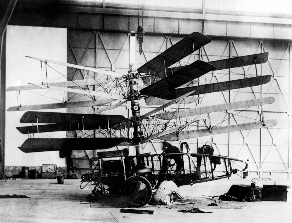 Engineer working on the Pescarra Helicopter. Developed by Argentine engineer Raúl Pescara in the early 1920s, it had two contra-rotating 'screws', each having four blades. Ca. 1920s. : Stock Photo