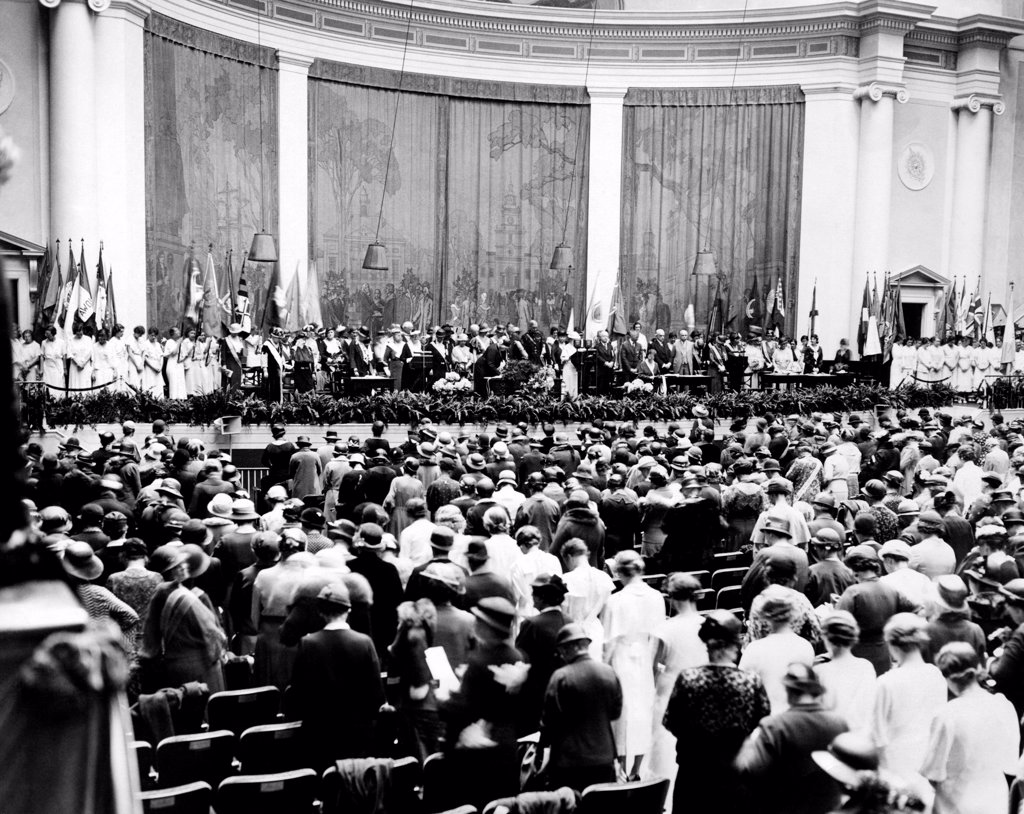 Daughters of the American Revolution begin their convention with a prayer in Constitution Hall. In 1938, the DAR refused to lease this auditorium for a concert by Marian Anderson because she was an African American. Washington, D.C. April 17, 1933. : Stock Photo