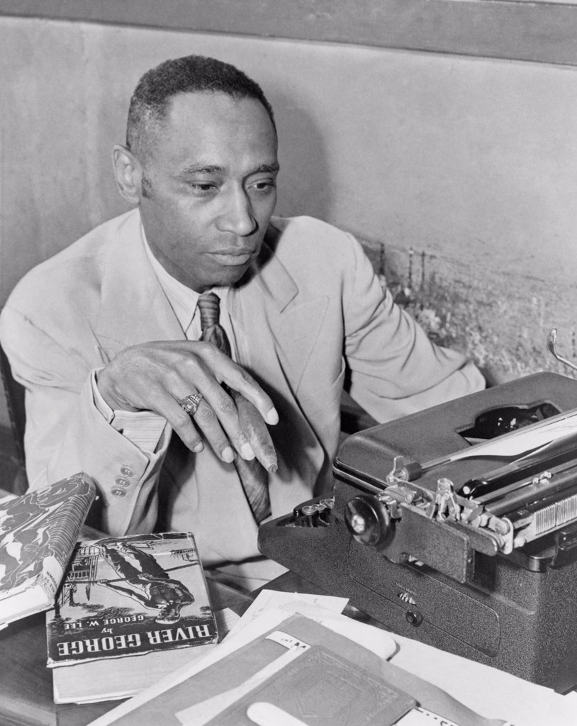 Stock Photo: 4048-10481 African American author George Washington Lee. He poses with his 1937 novel 'River George', about a young African American World War I veteran who returns home to injustice and is ultimately lynched. 1945.