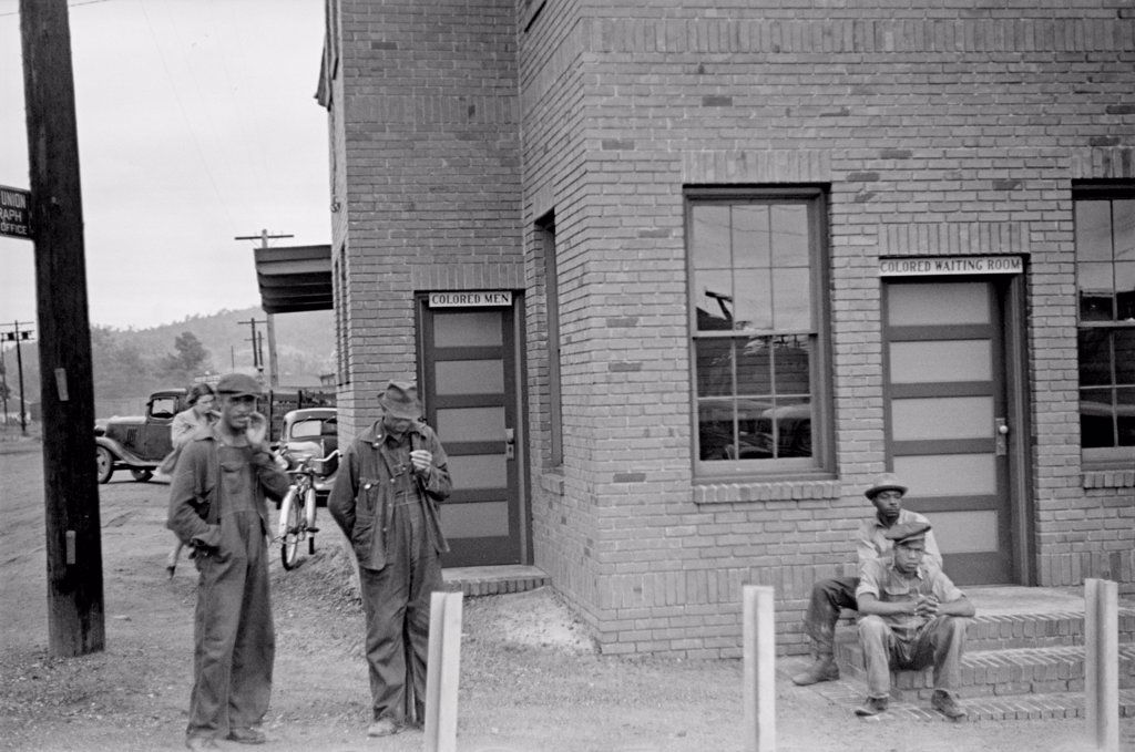Colored Waiting Room sign. Four African American men stand outside of the Manchester, Georgia, railroad station. May 1938. : Stock Photo