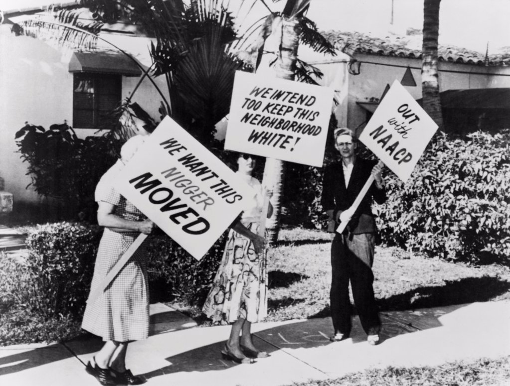 Stock Photo: 4048-10525 African American singer Frank Legree's home was picketed. Three White people carrying signs with racist slogans in front his house in Miami, Florida. 1957.