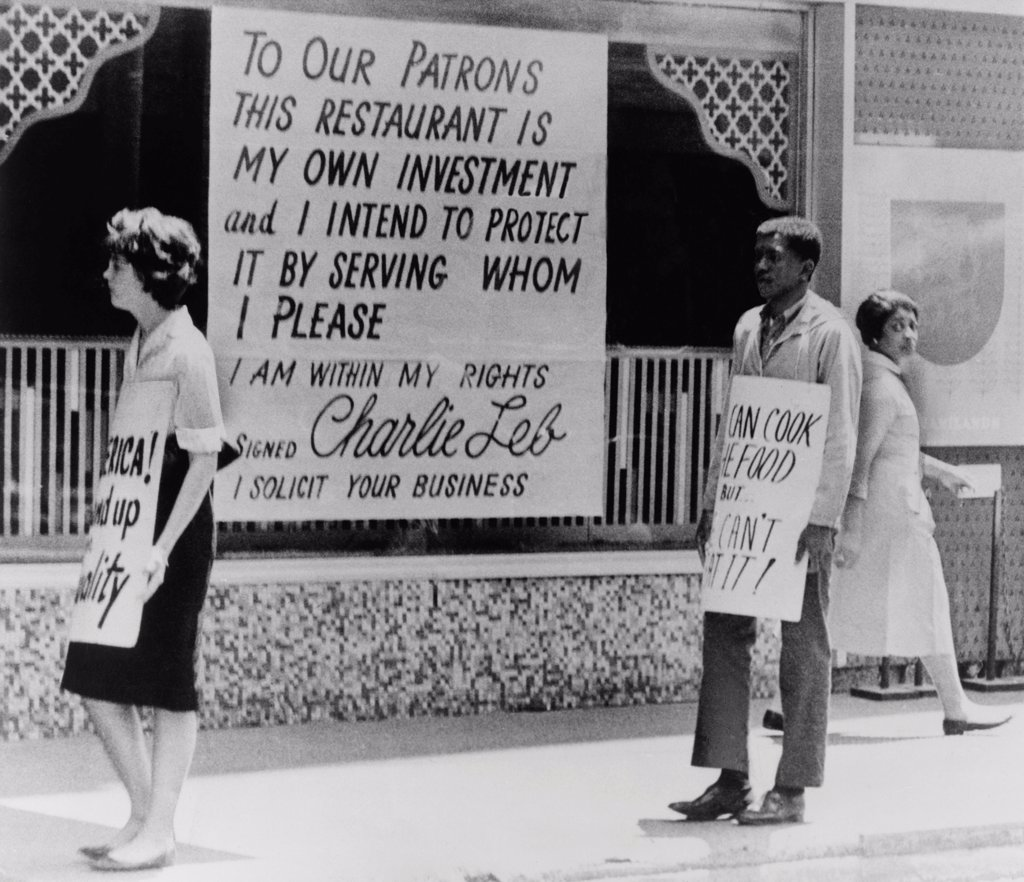 People picketing outside an Atlanta restaurant which displays a segregationist sign. 1963. : Stock Photo