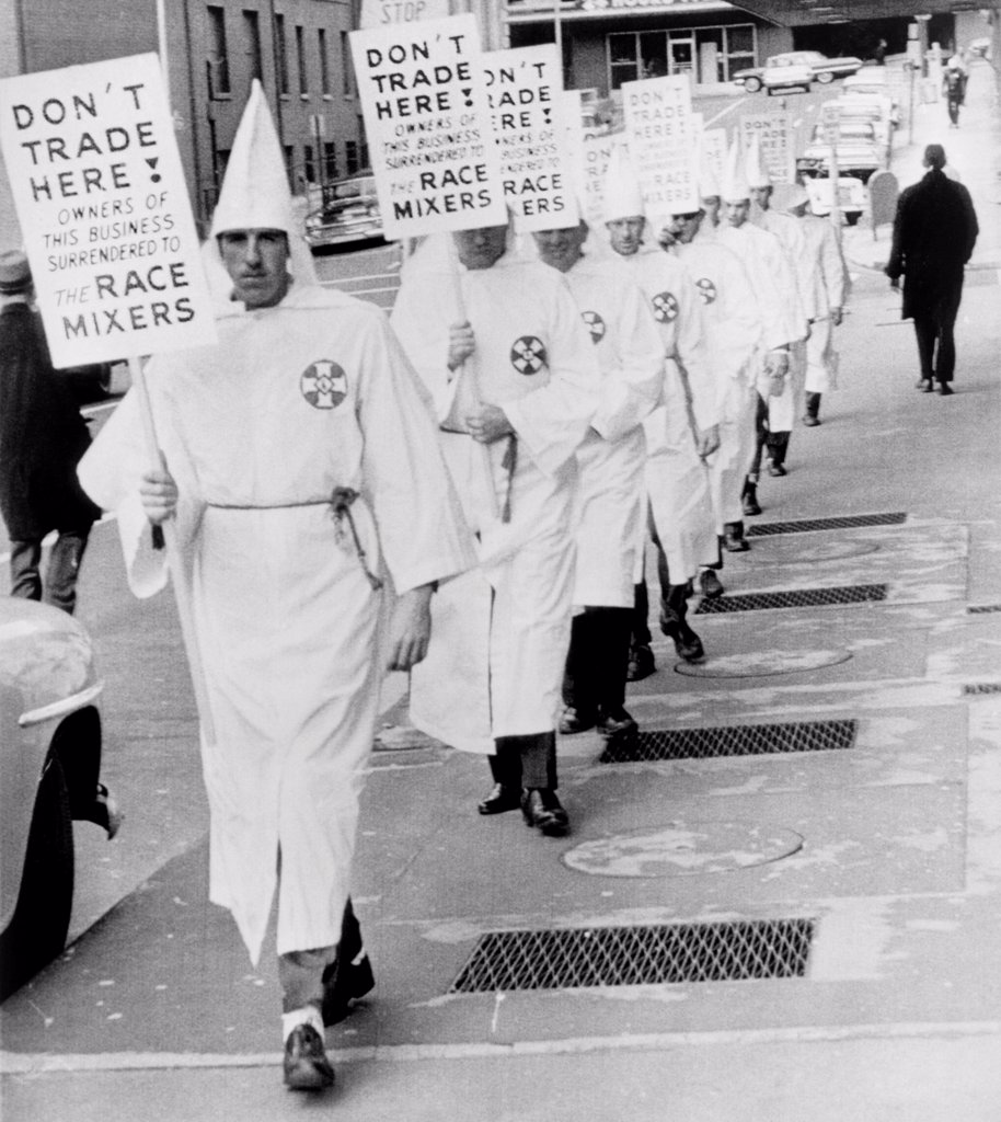 Stock Photo: 4048-10531 Ku Klux Klansmen picket newly desegregated hotel in Albany, Georgia. KKK was a militant minority intimidated moderates to resist racial integration of public facilities. Jan. 25, 1964.
